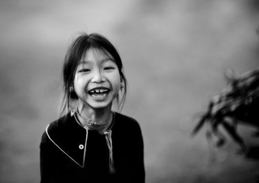 Lantaen minority child laughing, Nam deng, Laos