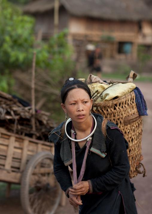 Lantaen minority woman carrying a basket, Nam deng, Laos