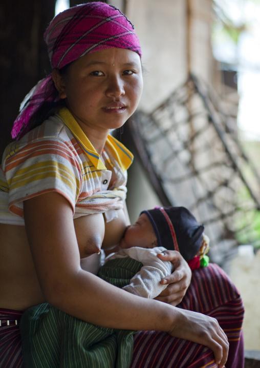 Akha minority breastfeeding woman, Muang sing, Laos