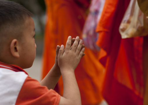 Lao buddhist monks collecting alms in luang prabang, Laos