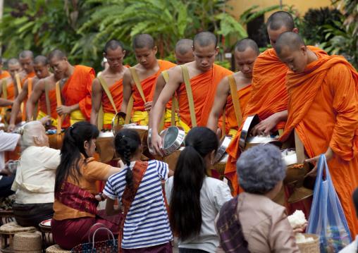 Lao buddhist monks collecting alms, Luang prabang, Laos