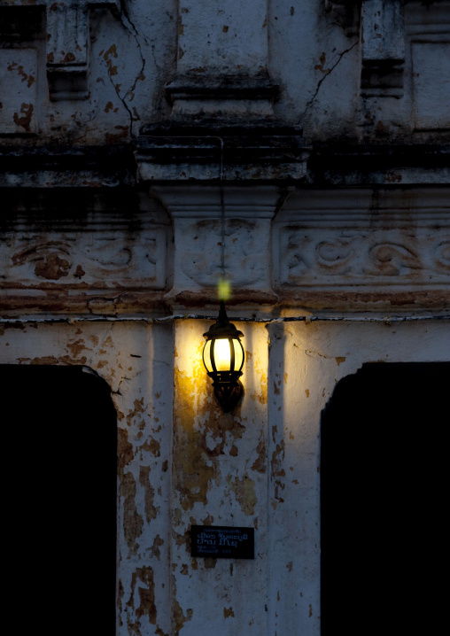 Lamp on a colonial building, Vientiane, Laos
