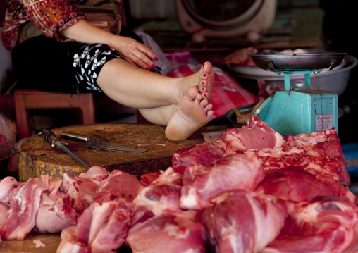 Butcher in a market, Vientiane, Laos