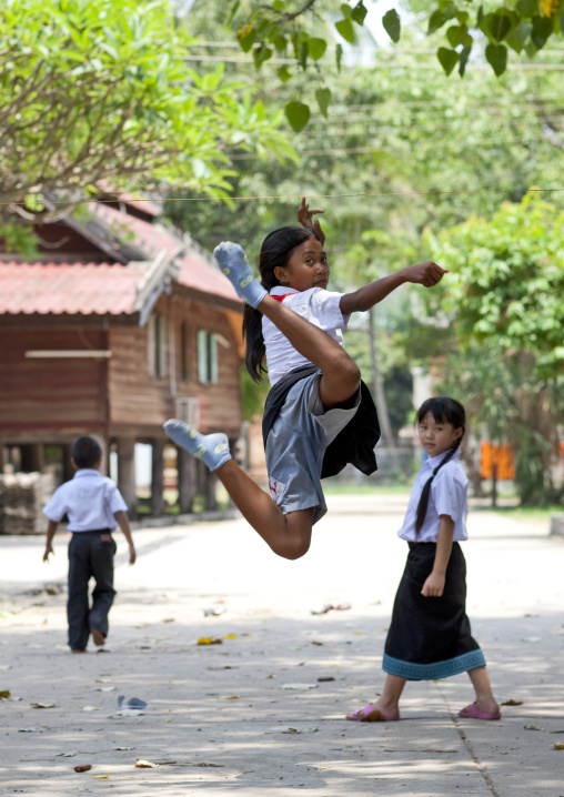 Lao girls palying in the street, Vientiane, Laos