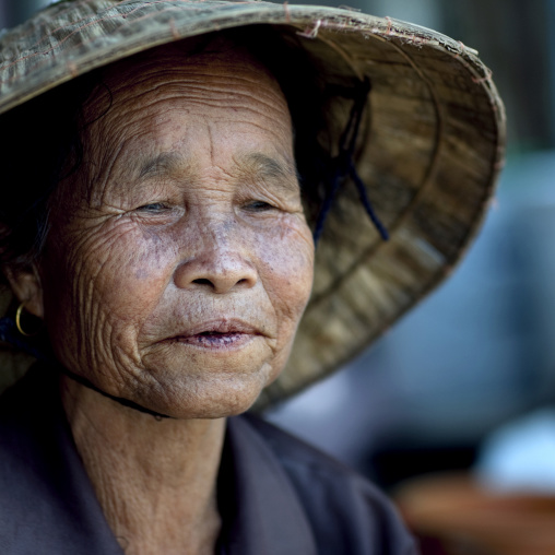Old woman with conical hat, Vientiane, Laos
