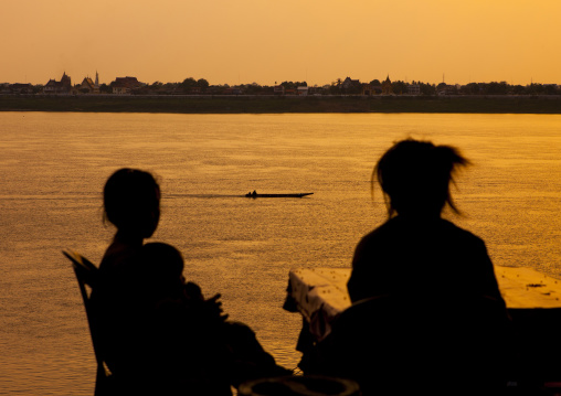 People in front of mekong river at sunset, Thakhek, Laos