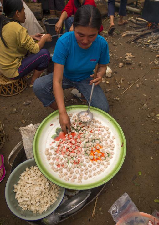 Women preparing meal for festivities, Louang namtha, Laos