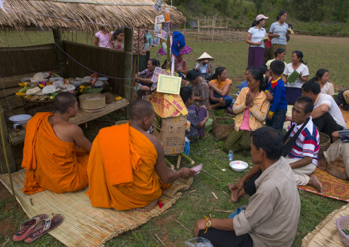 Family at death ceremony, Phonsavan, Laos