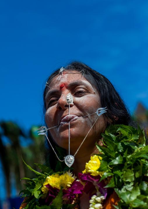 Hindu Devotee Woman With Pierced Tongue During Annual Thaipusam Religious Festival In Batu Caves, Southeast Asia, Kuala Lumpur, Malaysia
