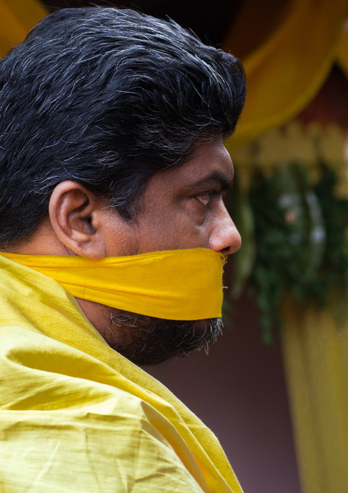 Hindu Devotee With Her Mouth Gagged To Keep Silence In Annual Thaipusam Religious Festival In Batu Caves, Southeast Asia, Kuala Lumpur, Malaysia