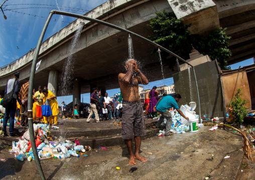 Hindu Pilgrim Taking Shower In Annual Thaipusam Religious Festival In Batu Caves, Southeast Asia, Kuala Lumpur, Malaysia