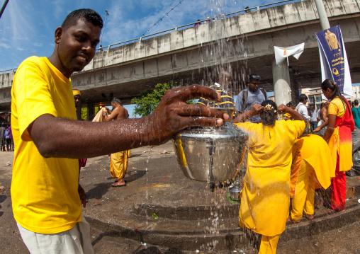 Hindu Pilgrim Collecting Water In A Jar In Annual Thaipusam Religious Festival In Batu Caves, Southeast Asia, Kuala Lumpur, Malaysia