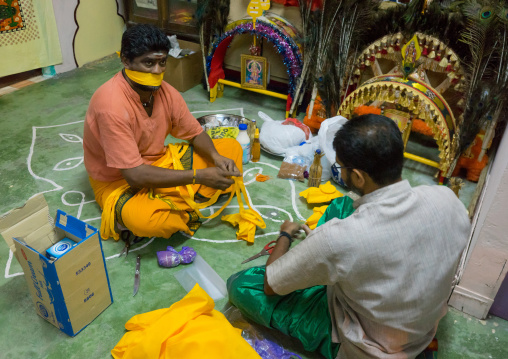 Hindu Devotee With His Mouth Gagged In Thaipusam Festival Preapring Offerings, Southeast Asia, Kuala Lumpur, Malaysia