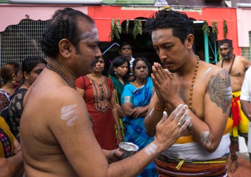 Hindu Devotee Praying In Annual Thaipusam Religious Festival In Batu Caves, Southeast Asia, Kuala Lumpur, Malaysia