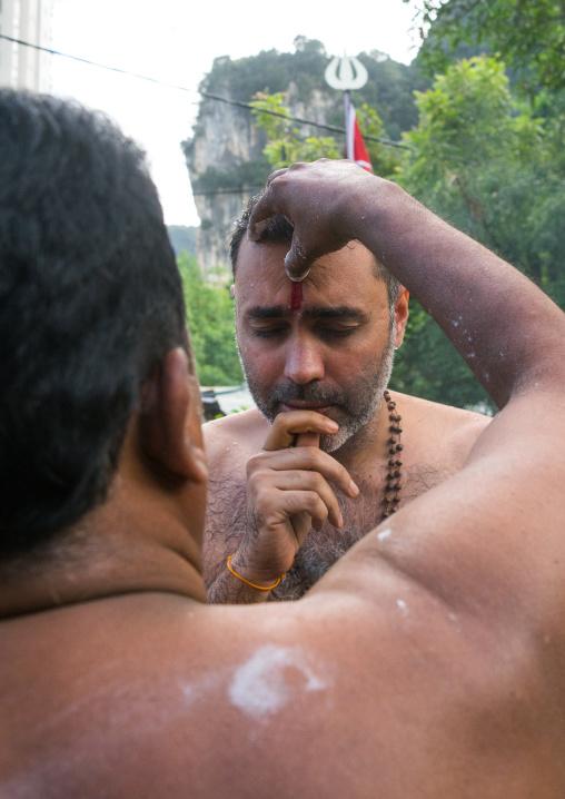 Hindu Priest Blessing A Devotee In Annual Thaipusam Religious Festival In Batu Caves, Southeast Asia, Kuala Lumpur, Malaysia