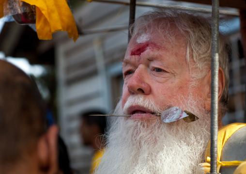 Carl, An Australian Hindu Devotee With A Skewer In The Tongue Carrying A Kavadi In Thaipusam Festival In Batu Caves, Southeast Asia, Kuala Lumpur, Malaysia