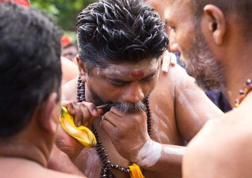 A Priest Piercing Himself With A Skewer At Thaipusam Hindu Festival At Batu Caves, Southeast Asia, Kuala Lumpur, Malaysia