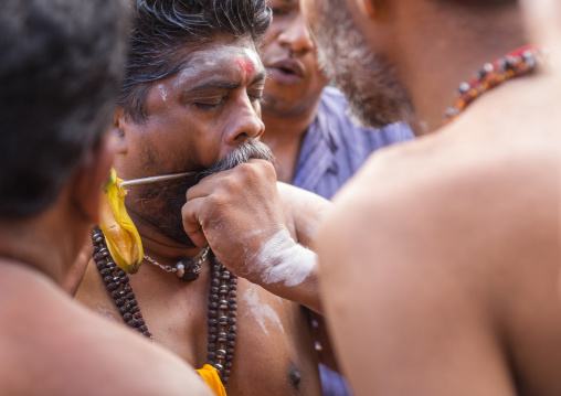 A Devotee Cheek Is Pierced Himself With A Skewer At Thaipusam Hindu Festival At Batu Caves, Southeast Asia, Kuala Lumpur, Malaysia