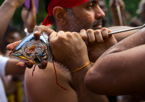 A Devotee Cheek Is Pierced With A Giant Skewer By A Priest At Thaipusam Hindu Festival At Batu Caves, Southeast Asia, Kuala Lumpur, Malaysia