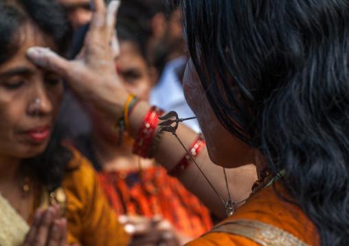 Hindu Woman Blessing A Devotee In Annual Thaipusam Religious Festival In Batu Caves, Southeast Asia, Kuala Lumpur, Malaysia