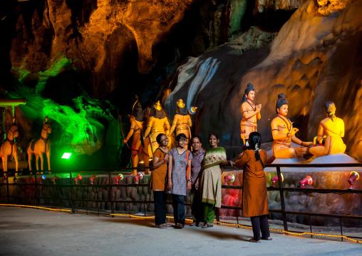 Tourists Looking At Hindu Figures In The Batu Caves, Southeast Asia, Kuala Lumpur, Malaysia