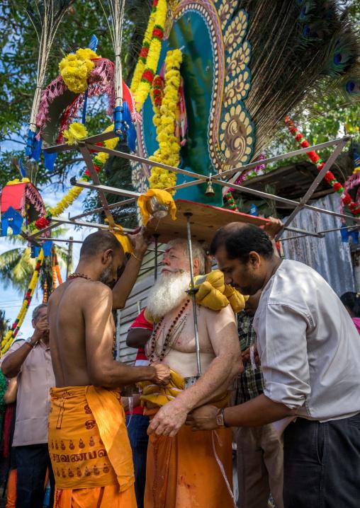 Devotee Kavadi Australian Bearer With Tongue Piercing At Thaipusam Hindu Religious Festival In Batu Caves, Southeast Asia, Kuala Lumpur, Malaysia