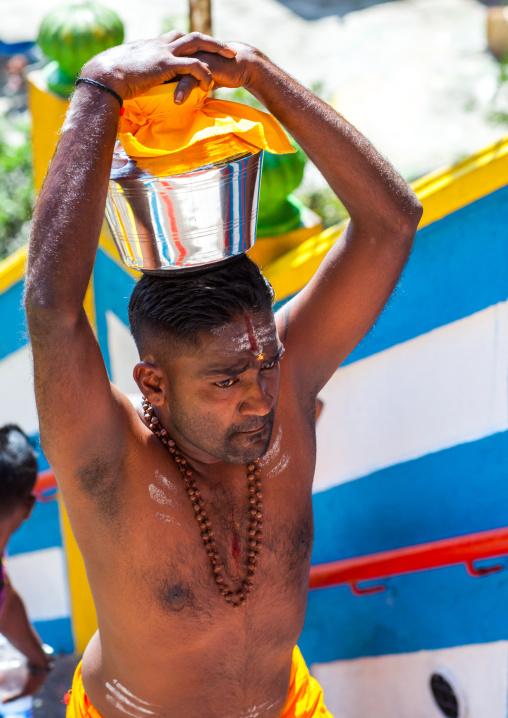 Hindu Devotee Man Carrying Water Jug On His Head In Annual Thaipusam Religious Festival In Batu Caves, Southeast Asia, Kuala Lumpur, Malaysia