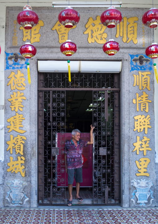 Chinese Man In The Entrance Of An Old Colonial House, Penang Island, George Town, Malaysia