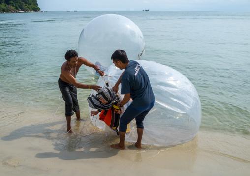 Muslim Tourist Inside A Water Walking Ball On Monkey Beach In Nan National Park, Penang Island, George Town, Malaysia