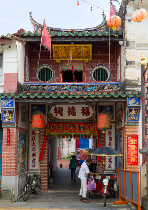 Rickshaw In Front Of An Old Chinese Temple, Penang Island, George Town, Malaysia