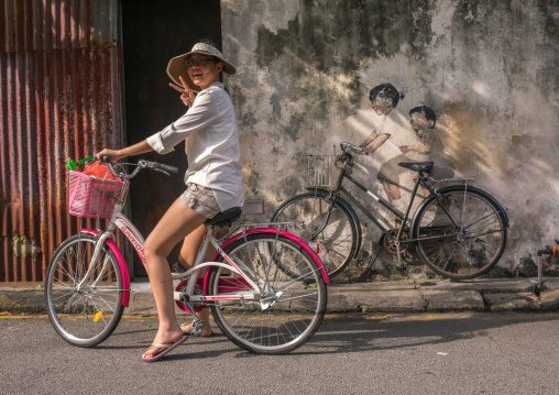 Tourist Posing For Photograph In Front Of A Street Arwotk By Lithuanian Artist Ernest Zacharevic, Penang Island, George Town, Malaysia