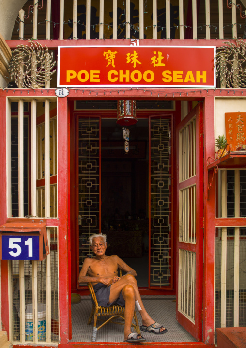 Old Man Sitting In Front Of His House In The Street, George Town, Penang, Malaysia