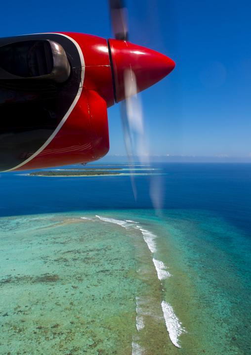 Maldivian Air Taxi Seaplane Flying Over An Atoll, Male, Maldives