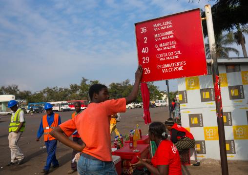 Men At A Bus Stop, Maputo, Mozambique
