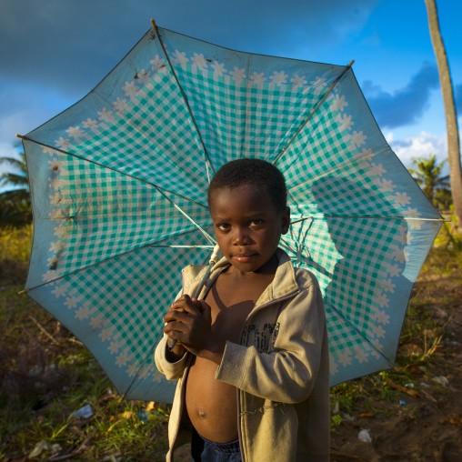Boy With An Umbrella In The Country, Inhambane, Inhambane Province, Mozambique