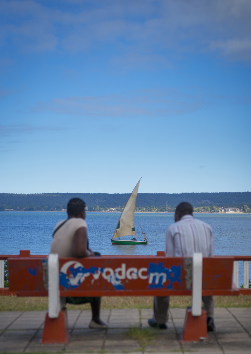 Couple On A Bench Looking At A Dhow, Inhambane, Mozambique