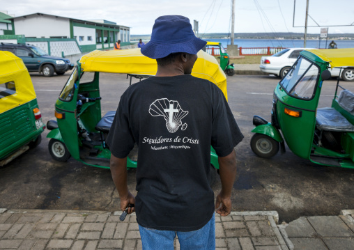 Man With A Christian Tshirt In Front Of Taxis, Inhambane, Mozambique