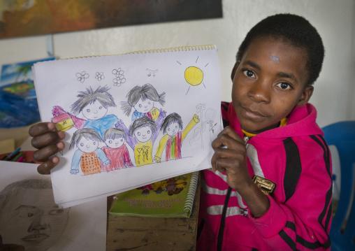 Boy Showing A Drawing In A School, Inhambane, Mozambique