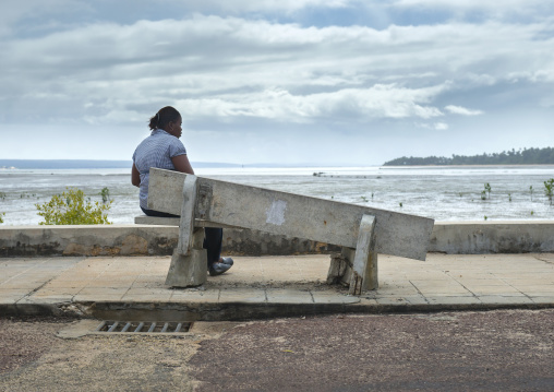 Woman In Front Of The Sea Sitting On A Broken Bench, Inhambane, Inhambane Province, Mozambique