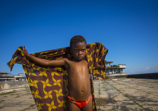 Kid Washing At The Top Of The Grande Hotel Slum, Beira, Mozambique