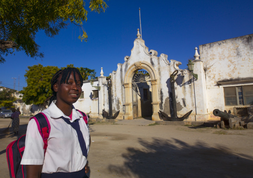 Girl In Front Of The Old Naval Academy In Stone Town, Island Of Mozambique, Mozambique
