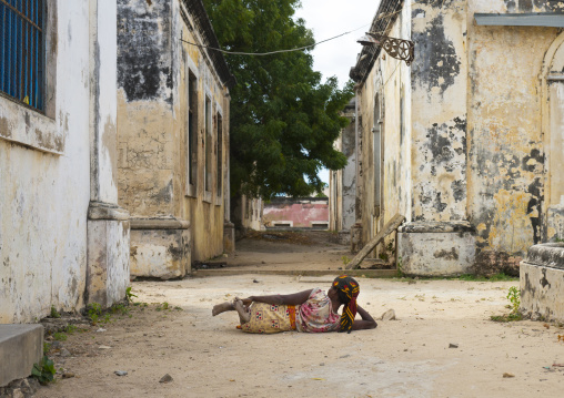 Woman Lying On The Ground Inside The Old Hospital, Island Of Mozambique, Mozambique