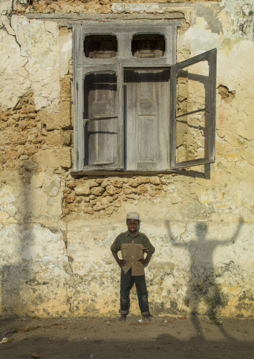 Kid Standing In Front Of An Old Window, Ibo Island, Cabo Delgado Province, Mozambique