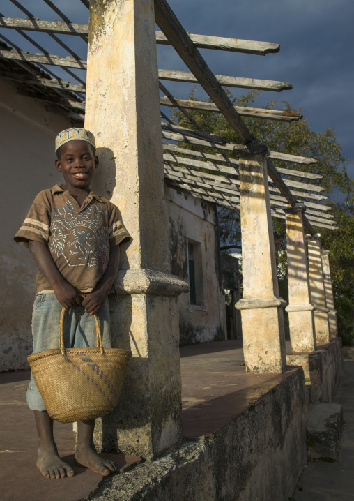 Kid Standing In Front Of An Old Portuguese Colonial House, Ibo Island, Mozambique