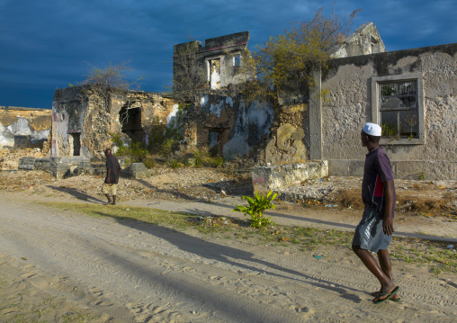 Men Passing In Front Of Some Old Portuguese Colonial Building, Ibo Island, Cabo Delgado Province, Mozambique