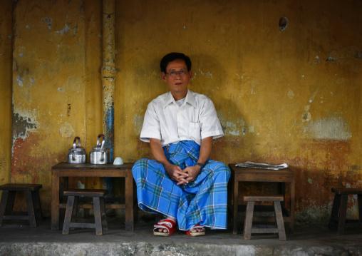Man sit in a cafe, Rangoon, Myanmar