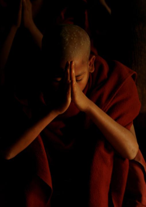 Novice Buddhist Monk Praying, Rangoon, Myanmar