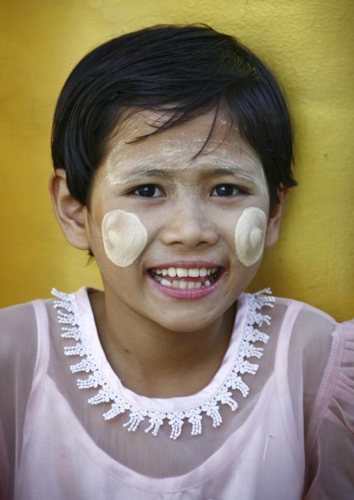 A Young Girl Smiling With Thanaka On Cheeks, Rangoon, Myanmar