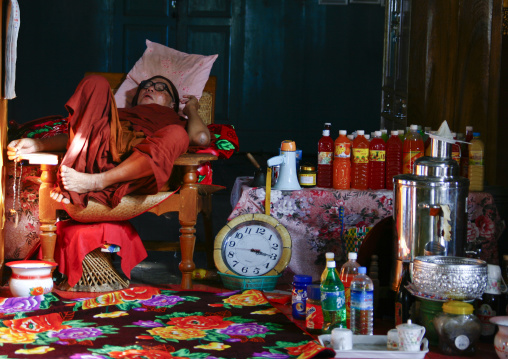 Buddhist monk sleeping in nga phae kyaung, Inle lake jumping cats monastery myanmar