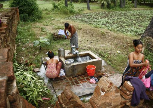 People Taking Bath In Innwa, Myanmar